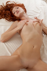 Red Haired Babe Stripteasing In Her Bed