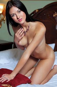 Lovely Brunette Riccarda Posing In Her Bed