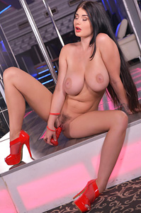 Big Boobed Stripper Lucy Li Plays With A Red Dildo