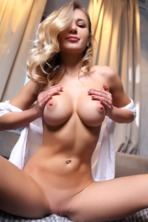 Hot blonde Candice B is looking good in her long white shirt and socks